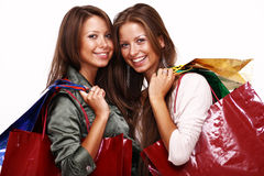 Sisters holding shopping bags on white isolated Stock Image