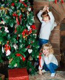 Sisters at home with Christmas tree stock image