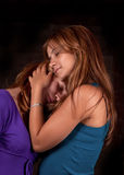 Sisters hugging royalty free stock photography