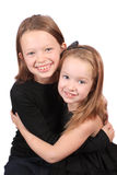 Sisters hugging Royalty Free Stock Image