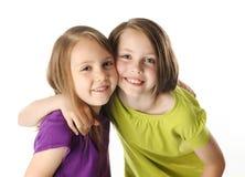 Sisters hugging Stock Image