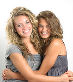 Sisters hugging Stock Images
