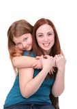 Sisters hugging Royalty Free Stock Photos