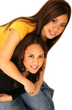 Sisters Hugging Each Other Looking From Above Stock Image