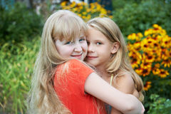 Sisters hugging Royalty Free Stock Photo