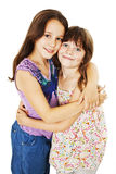 Sisters hugging. Isolated on white background royalty free stock photos