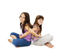 Sisters hugging. Isolated on white background royalty free stock photography