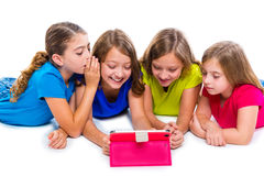 Sisters kid girls with tech tablet pc playing happy Royalty Free Stock Photos