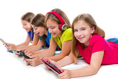 Sisters kid girls tech tablets and smatphones Stock Image