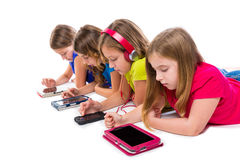 Sisters kid girls tech tablets and smatphones Royalty Free Stock Image