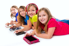 Sisters kid girls tech tablets and smatphones Royalty Free Stock Photography