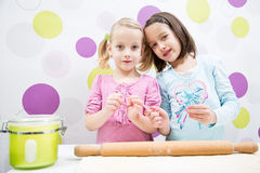 Sisters in kitchen Stock Images