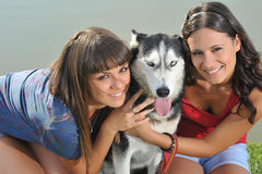 Sisters and l husky Royalty Free Stock Photo