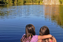 Sisters by the lake Stock Image