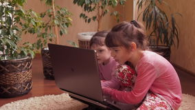 Sisters with laptop. Full HD stock footage
