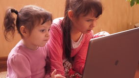 Sisters with laptop. Full HD stock video footage