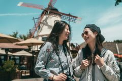 Sisters laughing while taking photos. royalty free stock photos