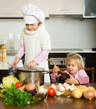 Sisters learn how to cook Stock Photography