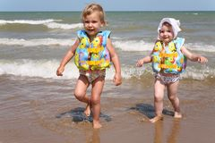 Sisters leave the sea Royalty Free Stock Image