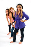 Sisters in line. Three teens sisters on a white background Stock Images