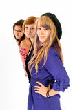 Sisters in line. Three teens sisters on a white background Royalty Free Stock Image