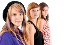 Sisters in line. Three teens sisters on a white background Stock Photography