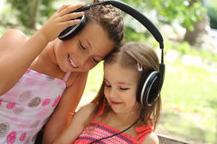 Sisters listen to the music together Stock Photo