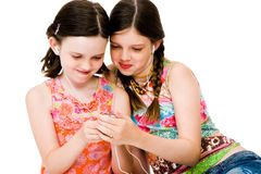 Sisters listening MP3 Stock Photo