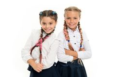 Sisters little girls with braids ready for school. School fashion concept. Be bright. School friendship. Sisterhood royalty free stock images