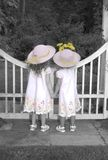 Sisters Looking Over Garden Gate Royalty Free Stock Photo