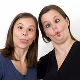 Sisters looking silly with puckered lips Stock Photography