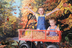 Sisters Loving Fall Royalty Free Stock Photos