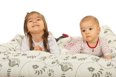 Sisters lying on bed Royalty Free Stock Images