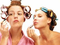 Sisters and makeup. Royalty Free Stock Images