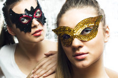 Sisters with masks Stock Photos