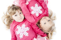 Sisters in Matching Winter Outfits royalty free stock photo