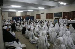 Sisters of The Missionaries of Charity at Mass in the chapel of the Mother House, Kolkata Stock Photography