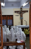 Sisters of Mother Teresa`s Missionaries of Charity in prayer in the chapel of the Mother House, Kolkata Stock Photo