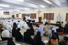 Sisters of Mother Teresa`s Missionaries of Charity and volunteers from around the world at the Mass in Mother House in Kolkata Royalty Free Stock Image