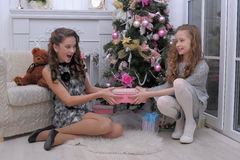 Sisters Near A Christmas Tree Royalty Free Stock Images