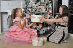 Sisters Near A Christmas Tree Stock Photo