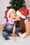 Sisters are in new-year caps. A sisters in the cap of Santa Claus Stock Photography