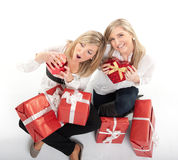 Sisters opening presents Stock Photos