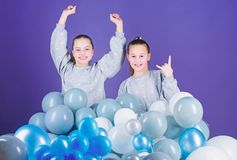 Sisters organize home party. Greeting concept. Having fun concept. Balloon theme party. Girls friends near air balloons. Start party. Birthday party royalty free stock images