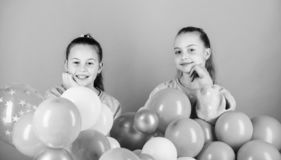 Sisters organize home party. Having fun concept. Balloon theme party. Girls best friends near air balloons. Start this. Party. Birthday party. Happiness and stock images