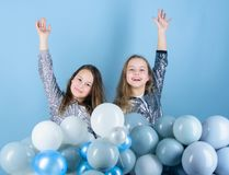Sisters organize home party. Having fun concept. Balloon theme party. Girls little siblings near air balloons. Birthday. Party. Happiness and cheerful moments royalty free stock photos