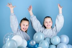 Sisters organize home party. Having fun concept. Balloon theme party. Girls best friends near air balloons. Birthday. Party. Happiness and cheerful moments stock photo
