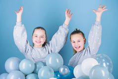 Sisters organize home party. Having fun concept. Balloon theme party. Girls best friends near air balloons. Birthday. Party. Happiness and cheerful moments royalty free stock image