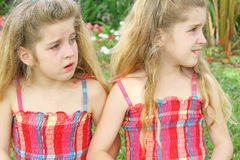 Sisters outside. Shot of identical twin sisters outside Stock Images