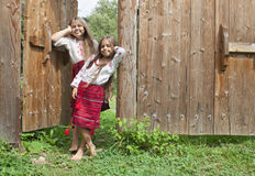 Sisters outside home Stock Photos